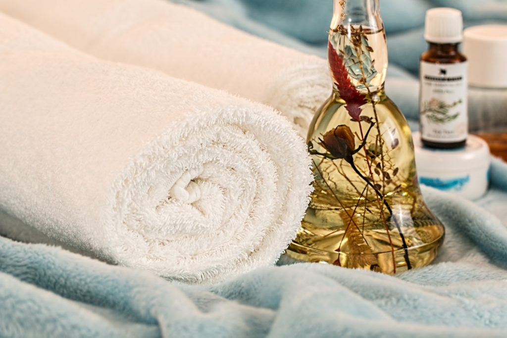 oil bottle next to wrapped towel