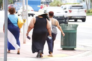 how to erase cellulite, large woman walking on street