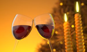 two glasses of wine toasting each other