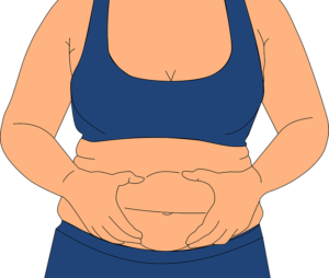 woman squeezing her tummy
