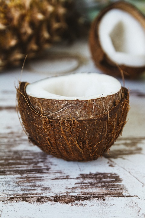 coconut sliced in half displaying coconut oil