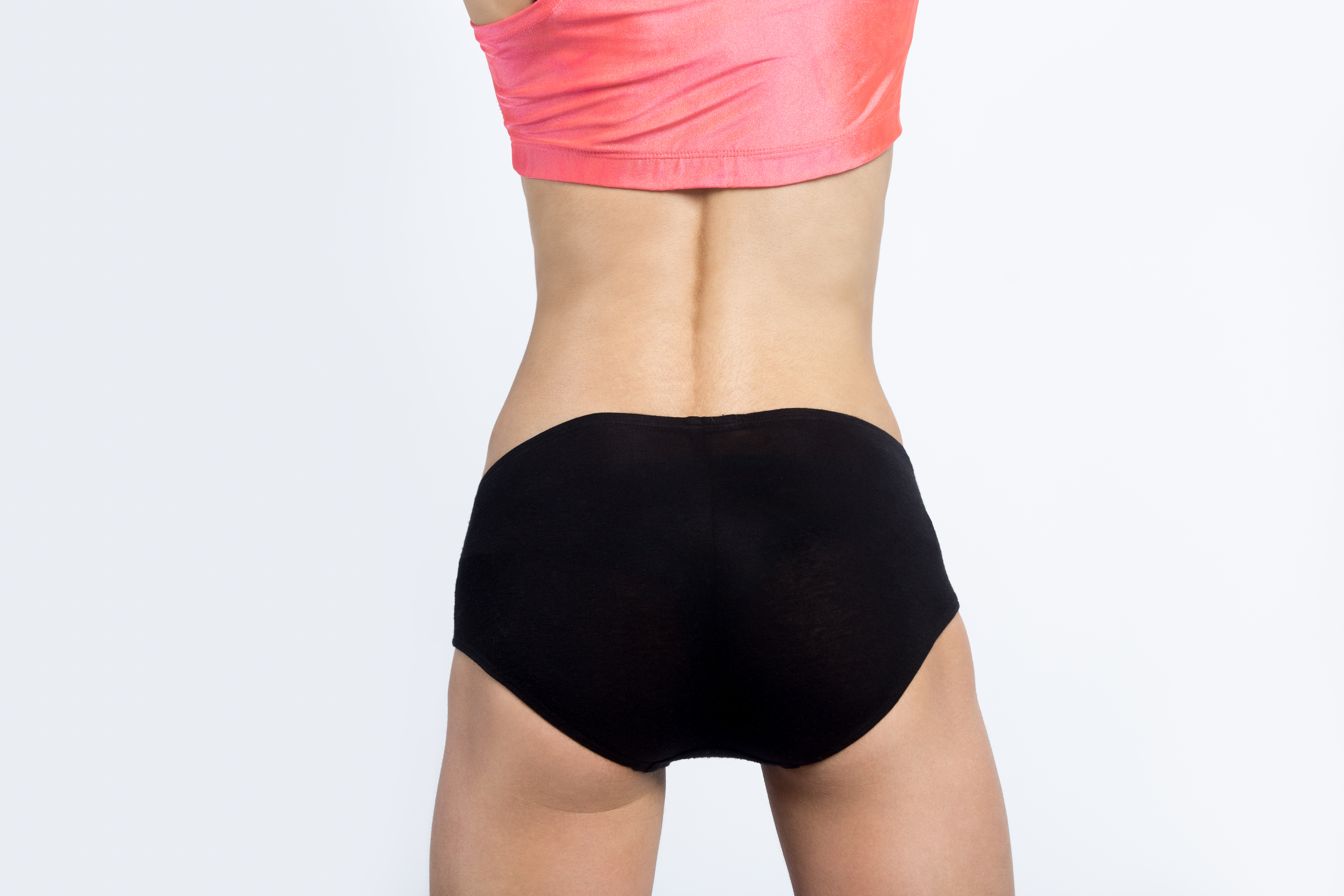 best workout for cellulite, woman showing off slim torso from behind