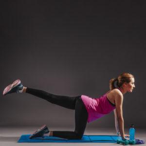 woman performing a leg lift