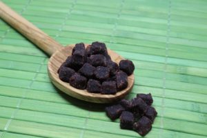 acai berries on a wooden spoon