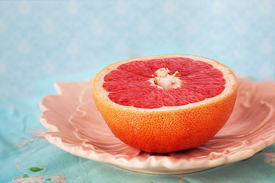 half a slice of pink grapefruit exposed
