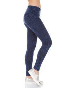 lower portion of female torso with slim fitting jeans