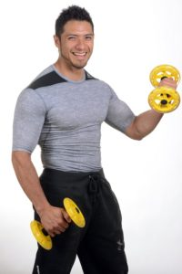 man using dumbbells to exercise