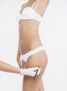 does body contouring work for cellulite, clinician examining womans thigh